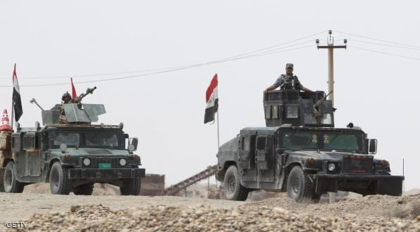"Iraqi security forces and paramilitaries deploy, on May 27, 2015, in al-Nibaie area, north-west of Baghdad, during an operation aimed at cutting off Islamic State (IS) jihadists in Anbar province before a major offensive to retake the city of Ramadi. Iraqi forces closed in on Ramadi and launched the operation dubbed Labaik ya Hussein"", which roughly translates as ""We are at your service, Hussein"" and refers to one of the most revered imams in Shiite Islam. It will see a mix of security forces and paramilitaries move south towards the city from Salaheddin province, said Hashed al-Shaabi (""popular mobilisation"" in Arabic) spokesman Ahmed al-Assadi. AFP PHOTO / AHMAD AL-RUBAYE        (Photo credit should read AHMAD AL-RUBAYE/AFP/Getty Images)"