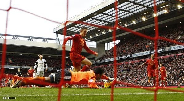 "Liverpool's Jordan Henderson (C) scores his second goal past Swansea's Michel Vorm (bottom) during their English Premier League soccer match at Anfield in Liverpool, northern England, February 23, 2014. REUTERS/Darren Staples (BRITAIN - Tags: SPORT SOCCER) FOR EDITORIAL USE ONLY. NOT FOR SALE FOR MARKETING OR ADVERTISING CAMPAIGNS. NO USE WITH UNAUTHORIZED AUDIO, VIDEO, DATA, FIXTURE LISTS, CLUB/LEAGUE LOGOS OR ""LIVE"" SERVICES. ONLINE IN-MATCH USE LIMITED TO 45 IMAGES, NO VIDEO EMULATION. NO USE IN BETTING, GAMES OR SINGLE CLUB/LEAGUE/PLAYER PUBLICATIONS"