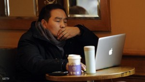 A man uses his computer in a coffee shop in Shanghai on February 2, 2012.  As Facebook prepares to go public it has its sights on China, where the social media titan is blocked, but analysts say its chances of re-entering the market of half a billion Internet users are slim. AFP PHOTO / Peter PARKS (Photo credit should read PETER PARKS/AFP/Getty Images)