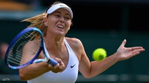 Russia's Maria Sharapova returns against US player Coco Vandeweghe during their women's quarter-finals match on day eight of the 2015 Wimbledon Championships at The All England Tennis Club in Wimbledon, southwest London, on July 7, 2015.  Sharapova won the match 6-3, 6-7, 6-2.  RESTRICTED TO EDITORIAL USE  -- AFP PHOTO / GLYN KIRK        (Photo credit should read GLYN KIRK/AFP/Getty Images)