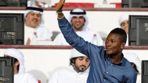 Ghana's football champion Asomoah Gyan waves to the crowd upon his arrival to attend a match at the Al-Ain Club in the Gulf emirate of Al-Ain on September 16, 2011. Gyan signed earlier in the week a contract to play for the Emirati club.  AFP PHOTO/STR (Photo credit should read -/AFP/Getty Images)