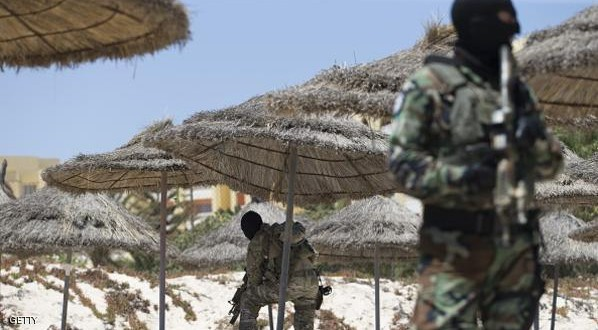 Masked Tunisian soldiers stand guard on the beach at the Riu Imperial Marhaba Hotel in Port el Kantaoui, on the outskirts of Sousse south of the capital Tunis, on June 29, 2015 where a deadly attack took place the previous week. Tunisia said it had made its first arrests after a beach massacre that killed 38 people, as European officials paid tribute to victims of the country's worst jihadist attack. AFP PHOTO / KENZO TRIBOUILLARD        (Photo credit should read KENZO TRIBOUILLARD/AFP/Getty Images)