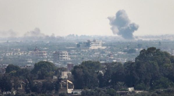 A picture taken from the Rafah border of the southern Gaza Strip with Egypt shows smoke billowing in Egypt's North Sinai on July 2, 2015. At least 70 people, mostly Egyptian soldiers but also civilians, were killed in attacks and ongoing clashes with Islamic State group jihadists. AFP PHOTO / SAID KHATIB        (Photo credit should read SAID KHATIB/AFP/Getty Images)
