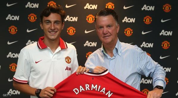 MANCHESTER, ENGLAND - JULY 11:  (EXCLUSIVE COVERAGE)  Matteo Darmian of Manchester United poses with Manager Louis van Gaal after signing for the club at Aon Training Complex on July 11, 2015 in Manchester, England.  (Photo by John Peters/Man Utd via Getty Images)