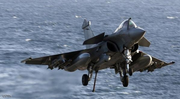 A French navy Rafale fighter jet returning from a mission over Iraq lands on the deck of the aircaft carrier Charles de Gaulle operating in the Gulf on February 26, 2015. French warplanes carried out their first strikes on February 25, 2015 since the warship joined the fight against jihadists in Iraq. AFP PHOTO / PATRICK BAZ        (Photo credit should read PATRICK BAZ/AFP/Getty Images)