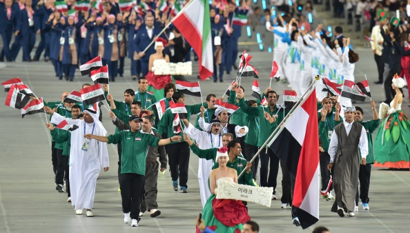 Iraq's Mahmmod Younus carries his national flag as he leads their delegation parade during the opening ceremony of the 2014 Asian Games at the Incheon Asiad Main Stadium in Incheon on September 19, 2014. AFP PHOTO / JUNG YEON-JE        (Photo credit should read JUNG YEON-JE/AFP/Getty Images)
