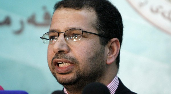 Salim al-Jubouri, spokesman of the Sunni Accordance Front and member of the Iraqi parliament, speaks to the media after lawmakers approved an amendment to the election law at the Iraqi parliament building in Baghdad December 6, 2009. REUTERS/Saad Shalash (IRAQ POLITICS) - RTXRJZK