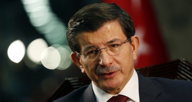 Turkey's Prime Minister Ahmet Davutoglu speaks during an interview with Reuters in Istanbul January 16, 2015. Davutoglu said on Friday the Syrian city of Aleppo must be protected from bombardment by President Bashar al-Assad's forces before Turkey would consider stepping up its role in the U.S.-led coalition against Islamic State. REUTERS/Murad Sezer (TURKEY - Tags: POLITICS HEADSHOT) - RTR4LQJ2