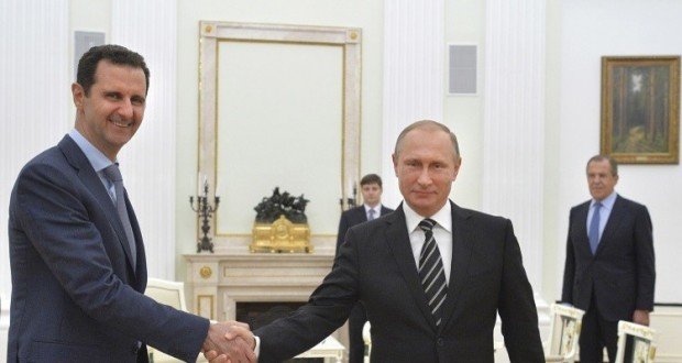 Russian President Vladimir Putin (R) shakes hands with Syrian President Bashar al-Assad during a meeting at the Kremlin in Moscow, Russia, October 20, 2015. Assad made a surprise visit to Moscow on Tuesday evening to thank Putin for launching air strikes against Islamist militants in Syria. Picture taken October 20, 2015. REUTERS/Alexei Druzhinin/RIA Novosti/Kremlin ATTENTION EDITORS - THIS IMAGE HAS BEEN SUPPLIED BY A THIRD PARTY. IT IS DISTRIBUTED, EXACTLY AS RECEIVED BY REUTERS, AS A SERVICE TO CLIENTS.        TPX IMAGES OF THE DAY      - RTS5E1K