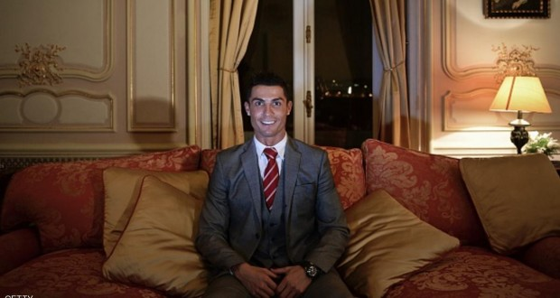 """Real Madrid's player Cristiano Ronaldo smiles as he poses for a photo after attending an AFP interview at Pestana Hotel Palace in Lisbon on December 17, 2015. Cristiano Ronaldo will invest over 37 million euros in the Pestana hotel group to create four new hotels with the """"CR7"""" logo in Portugal, Madrid and New York.   AFP PHOTO / PATRICIA DE MELO MOREIRA  TO GO WITH AN AFP STORY BY OLIVIER DEVOS / AFP / PATRICIA DE MELO MOREIRA        (Photo credit should read PATRICIA DE MELO MOREIRA/AFP/Getty Images)"""