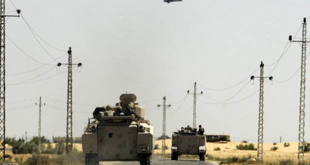 Egyptian soldiers and a military helicopter are deployed in the area of the Rafah Crossing border between Egypt and the Gaza Strip on May 21, 2013 as Egypt intensified efforts to secure the release of seven security personnel captured in the Sinai. Tensions remained high in the peninsula after two attacks by gunmen on or near police camps, and the kidnap last week of three policemen and four soldiers.  AFP PHOTO / STR        (Photo credit should read STR/AFP/Getty Images)