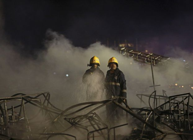"""Firefighters try to extinguish a fire at the venue of a cultural event during 'Make in India' week in Mumbai, India, February 14, 2016. A huge fire engulfed the venue of a cultural event in Mumbai on Sunday that was being held at the opening of a """"Make in India"""" week launched by Prime Minister Narendra Modi to drum up foreign investment. REUTERS/Danish Siddiqui"""
