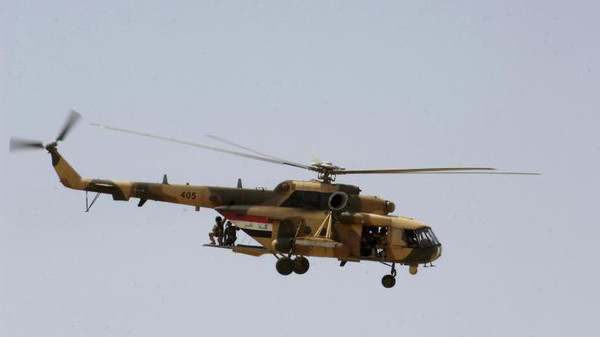 An Iraqi Mi-171 helicopter prepares to drop Iraqi special operations forces personnel into the middle of Exercise Lion's Leap April 26. The exhibition held near Baghdad was just one of several ongoing, multi-phase demonstrations designed to further integrate the Iraqi air force, Iraqi Army Aviation Command and Iraqi army. It was also an opportunity for the Iraqi military to showcase its capabilities.