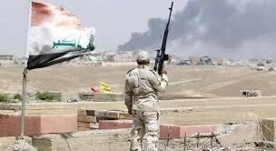 تحرير الزنكورة ورفع العلم العراقي فوق احد مبانيها