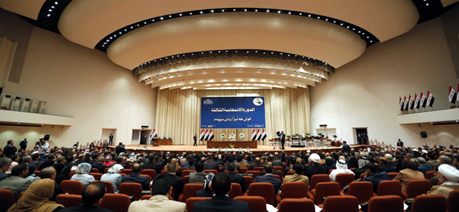 Members of the new Iraqi parliament attend a session at the parliament headquarters in Baghdad July 1, 2014. Sunnis and Kurds abandoned the first meeting of Iraq's new parliament on Tuesday after Shi'ites failed to name a prime minister to replace al-Maliki, wrecking hopes that a unity government would be swiftly built to save Iraq from collapse. Parliament is not likely to meet again for at least a week, leaving the country in a state of political limbo. REUTERS/Thaier Al-Sudani (IRAQ - Tags: POLITICS CIVIL UNREST)