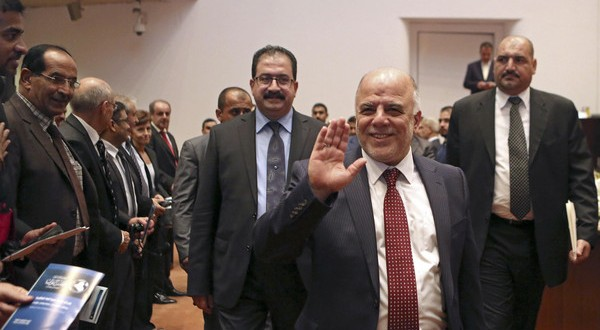 Iraq's new Prime Minister Haider al-Abadi (C) attends a parliament session to submit his government in Baghdad September 8, 2014. Iraq's parliament approved a new government headed by Haider al-Abadi as prime minister on Monday night, in a bid to rescue Iraq from collapse, with sectarianism and Arab-Kurdish tensions on the rise.   REUTERS/Hadi Mizban/Pool (IRAQ - Tags: POLITICS ELECTIONS)